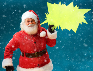 Smiling Santa Claus with sign speech bubble banner. Happy Santa Claus on blue background. Merry Christmas & New Year's Eve concept.