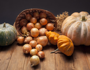 autumn pumpkins and other fruits and vegetables on wooden table