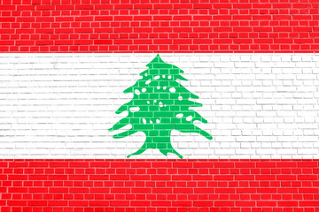 Flag of Lebanon on brick wall texture background
