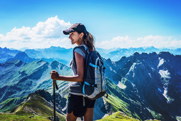 Fotomurales - Attractive young woman trekking in the Alps