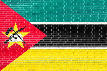 Flag of Mozambique, brick wall texture background