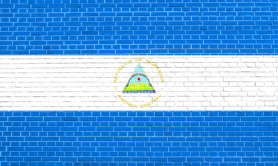Flag of Nicaragua on brick wall texture background