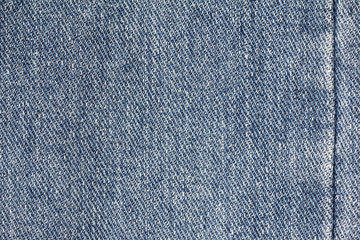 Denim jeans texture or denim jeans background with seam. Old grunge vintage denim jeans. Stitched texture denim jeans background of jeans fashion design.