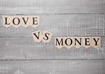 love vs money paper letters symbol motivation sign