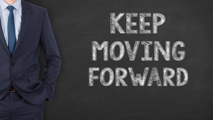 Keep Moving Forward Writing on Chalkboard