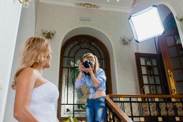 Wedding photographer is shooting portrait of the bride