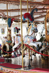 Beautiful white horses on a merry go round
