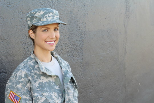 Smiling female soldier standing with copy space
