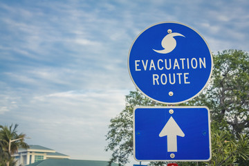 Hurricane Evacuation Route Road Sign on blue with arrow