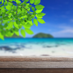 Wood table top on blurred beach background