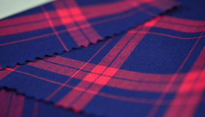 close up dark blue and red scott pattern fabric of shirt