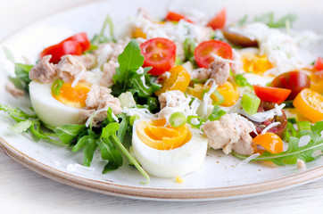 Fish salad with eggs and tomatoes.