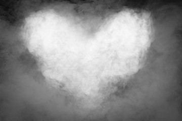 Smoke heart shape in the dark with movement of smoke for background.