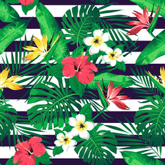 Tropical flowers and leaves on striped background. Seamless. Vector.