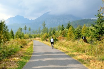 Senior man on bicycle in High Tatra Mountains, Slovakia.