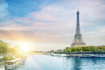 Romantic sunset background. Eiffel Tower with boats on Seine river in Paris, France. Wall mural