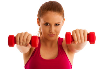 fitness gym - woman works out with dumbbells isolated over white