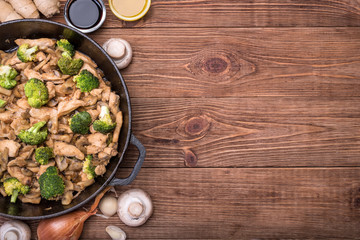 Chicken with broccoli and mushroom stir fry. Concept of cooking.