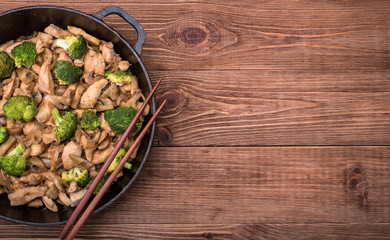 Chicken with broccoli and mushroom stir fry.