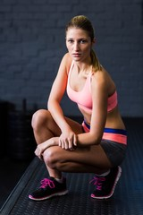 Portrait of fit serious woman in gym