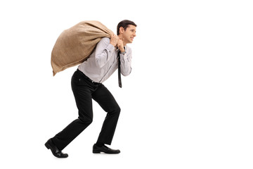 Businessman carrying a sack