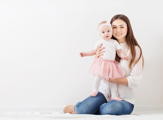 Mother and baby  together at home