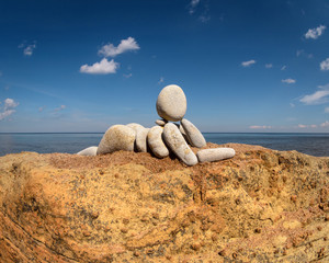 Figurine on coast