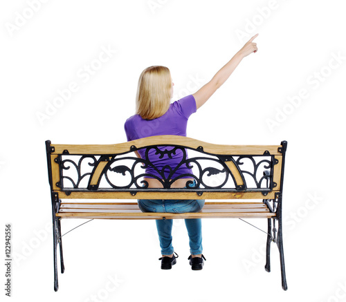 People Sitting At Table White Background. Back View Of Pointing Woman  Sitting On A Bench