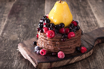 chocolate pancakes with berry fruit and honey