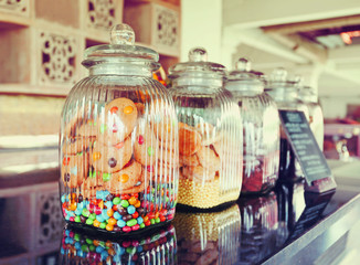 Colorful Candies in glass jars in candy shop