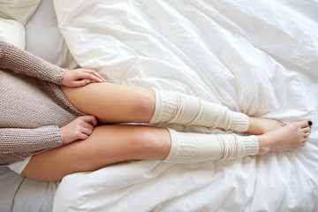 close up of young woman lying in bed at home