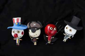 Halloween concept, wooden doll ghost collection on black background