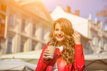 Happy woman on a sunny day with  glass of drink