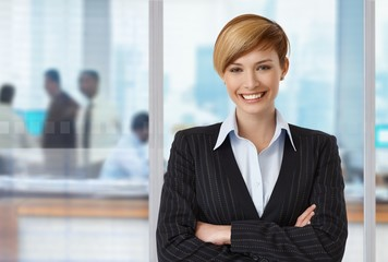 Happy elegant businesswoman at office