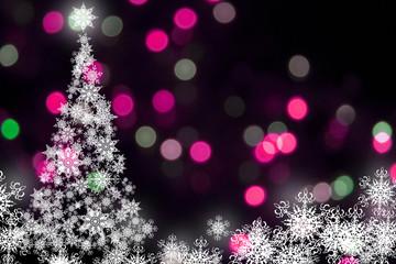 White snowflakes christmas tree at the pink bokeh background