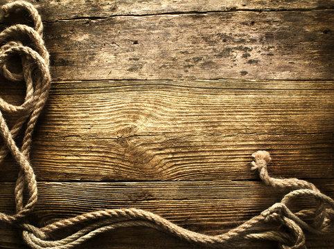 old rope on vintage wooden background