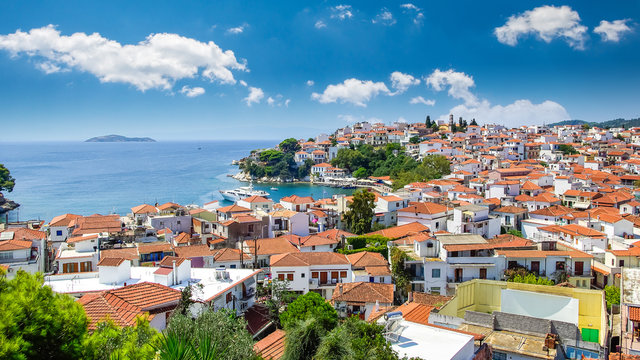Skiathos town on Skiathos Island, Greece. Beautiful view of the old town with boats in the harbor.
