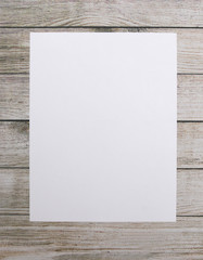 Blank Paper on a Light Wood Background