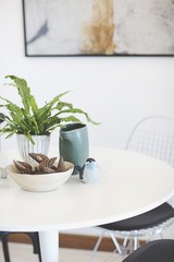 white table with tree pot,vase,bird sculpture and dried pine cones