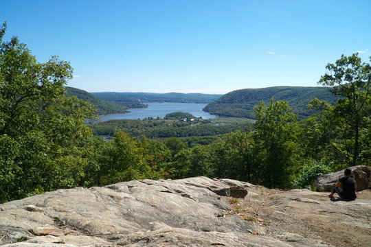 Overhead view from Bear Mountain Park, New York in the summer. Overlooking the Hudson River towards the big city. Visitors hike the mountain trails to the summit for fun and recreation.