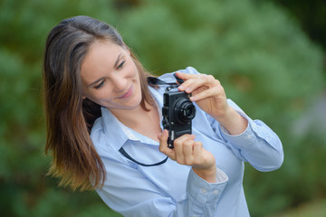 a young woman taking some pictures