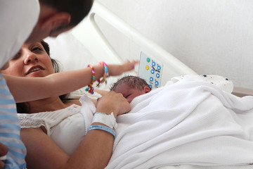 newborn and family together in hospital room