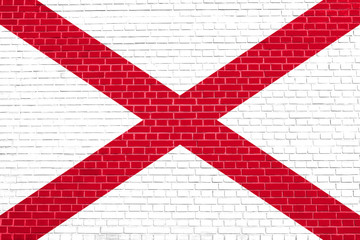 Flag of Alabama on brick wall texture background