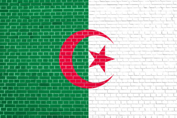 Flag of Algeria on brick wall texture background