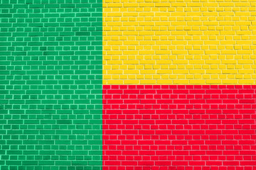 Flag of Benin on brick wall texture background