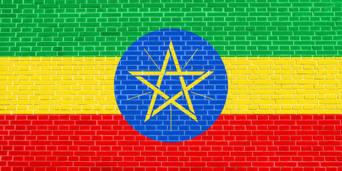 Flag of Ethiopia on brick wall texture background