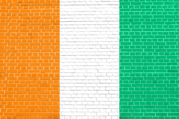 Flag of Ivory Coast, brick wall texture background