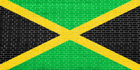 Flag of Jamaica on brick wall texture background