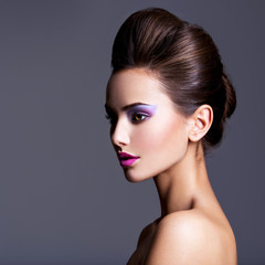 Spoed Fotobehang Beauty Fashion portrait of a beautiful girl with creative hairstyle an