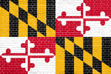 Flag of Maryland on brick wall texture background